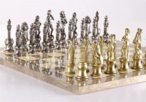 gold and silver metal chess sets